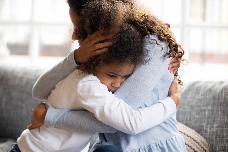 Mum hugging upset child